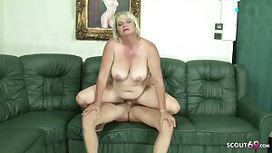 Fat granny with hairy slit is bouncing up and down while fucking a much younger guy